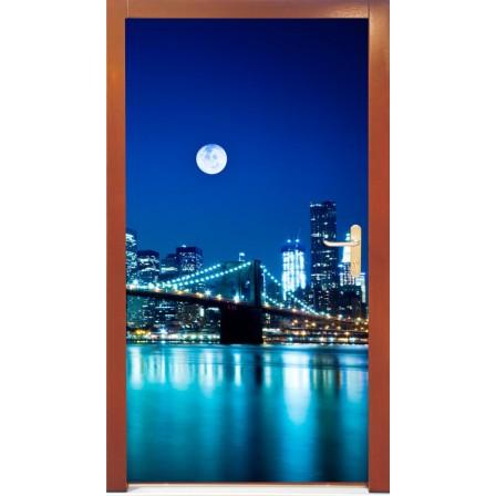 Naklejka na drzwi -księżyc nad miastem