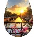 Naklejka Deska sedesowa - rower, rzeka, miasto, łodzie
