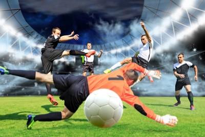 Grający piłkarze gol bramka bramkarz zawodnicy piłka nożna stadion kibice